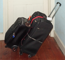 One of our 26' suitcase and small carry-on bag combinations strapped together